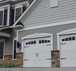 Carriage house garage doors installation.
